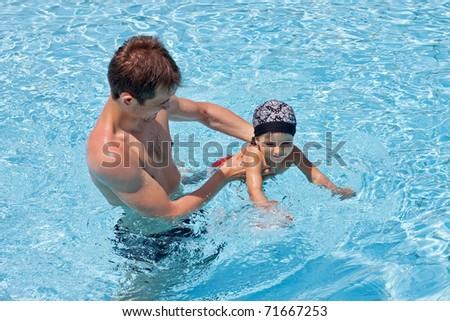 Father teaching his son to swim