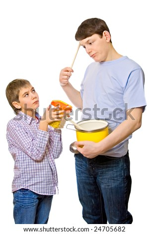 Father try to prepare dinner for son, isolated over white
