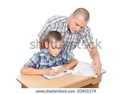 Father verifying son's homework, isolated on white background