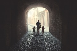 Father walking with his two daughters