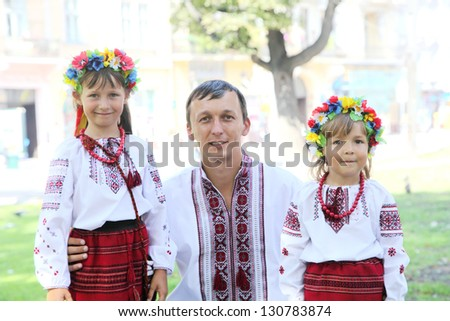 Father with a small daughter in embroidery. Ukrainian national costumes