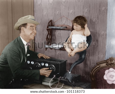 father with baby in speaker...