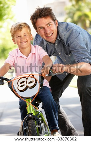 Father with boy on bike