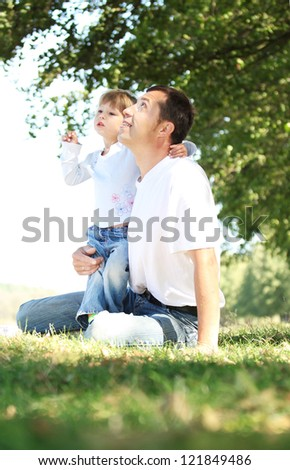father with child playing on the grass