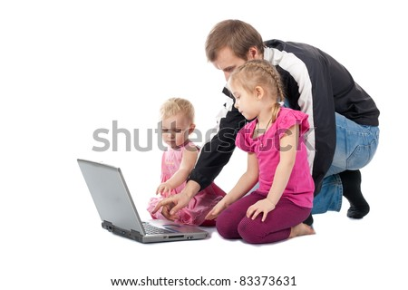 Father with children playing computer games on laptop against white background