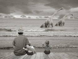 Father with children watching two dinosaurs in the Sea