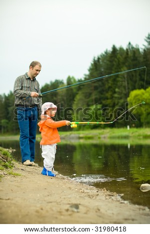 father with daughter fishing