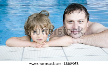 Father with her daughter in swimmig pool