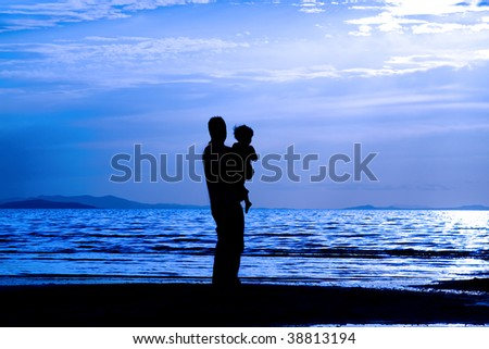 Father with his son by the beach - silhouette