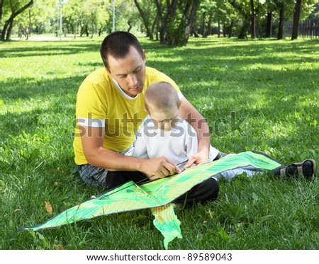 Father with his son in the summer park