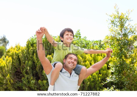 Father with his son playing in the garden