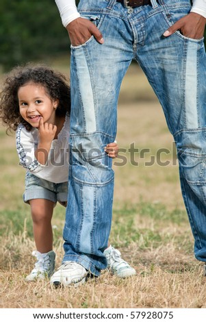 Father with little daughter playing in park