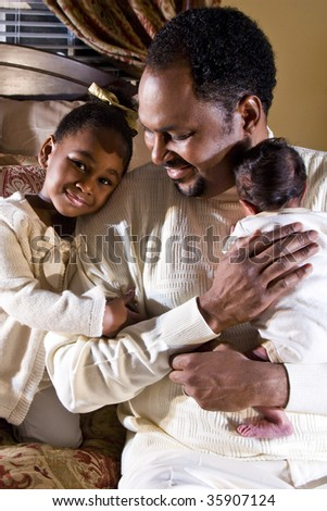 Father with newborn son and four year old daughter