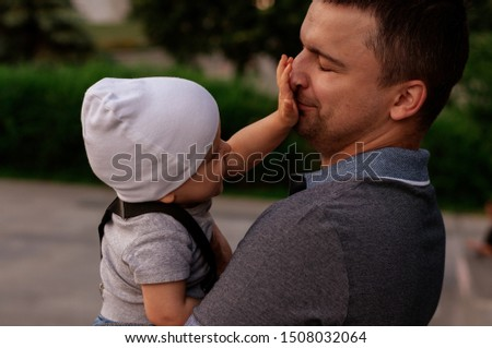 Father with one year old baby in his arms. Walk in an urban environment. The concept of urbanization and life in the city. The development of emotional intelligence. Early development #1508032064