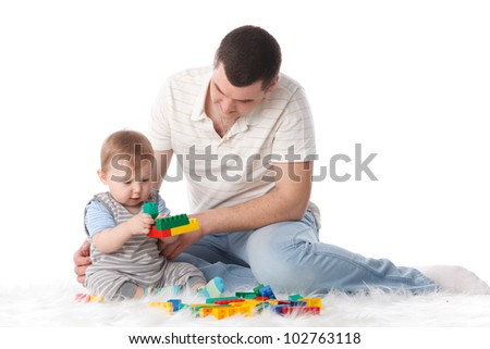 Father with small baby play on a white background.