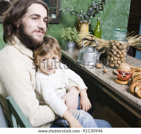 father with son at countryside kitchen