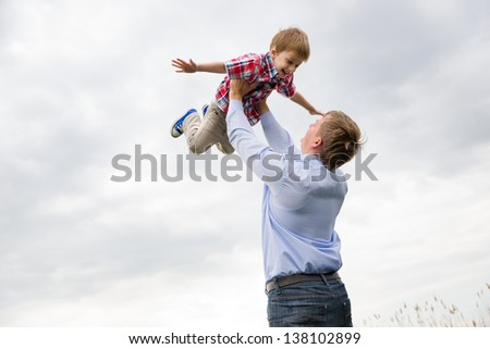 father with son having fun