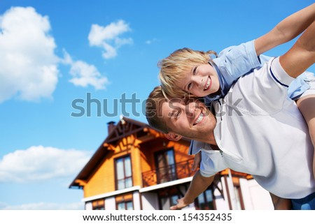 Father with son on the background of sky