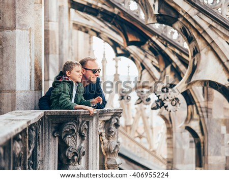 Father with son on the roof of Duomo di Milano #406955224