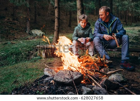 father with son warm near...