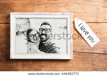 Fathers day concept. Picture frame. Wooden background.