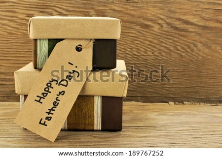 Fathers Day gifts with tag over a wooden background