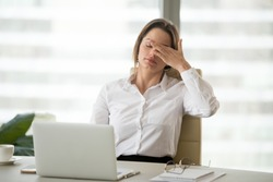 Fatigued businesswoman tired of computer work, female office worker feels dizzy from lack of sleep, headache, hormonal imbalance, eye strain tension, exhausted after long laptop use, overwork concept