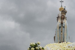 Fatima, Portugal May 13, 2018 - Procession of Our Lady of Fatima catholic virgin Mary statue. In the background The Sanctuary of Fatima.