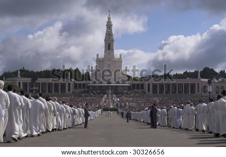 FATIMA, PORTUGAL - MAY 13: Worshipers attend an international pilgrimage at Fatima Sanctuary May 13, 2009 in Fatima. Fatima is one of the most important shrines of the world dedicated to Virgin Mary.
