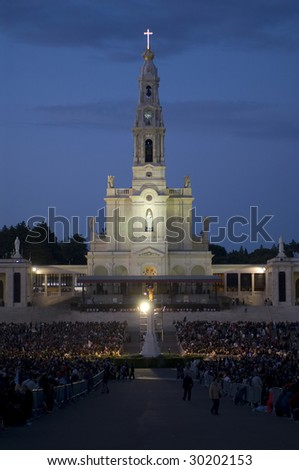 FATIMA, PORTUGAL - MAY 13: Worshippers attend an international pilgrimage at Fatima Sanctuary May 13, 2009 in Fatima. Fatima is one of the most important shrines of the world dedicated to Virgin Mary.