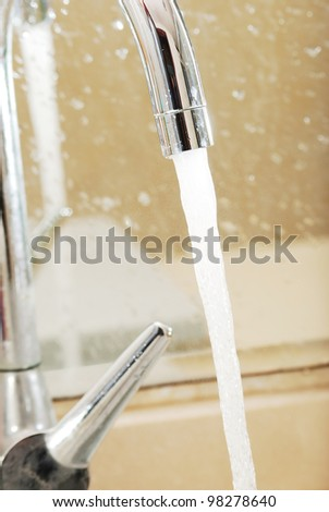 Faucet and water drop isolated on white background