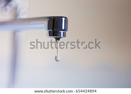 Faucet and water drops #654424894