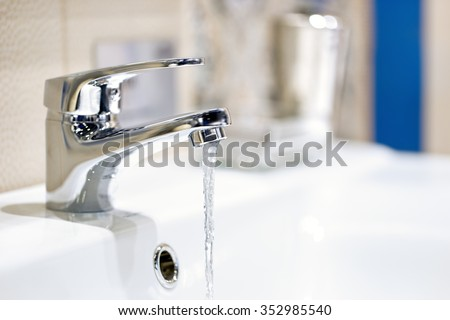 faucet and water flow                   #352985540
