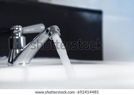 Faucet and water flow on bathroom #692414485