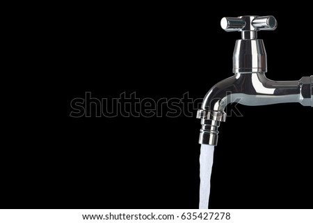 Faucet and water flow on black background #635427278