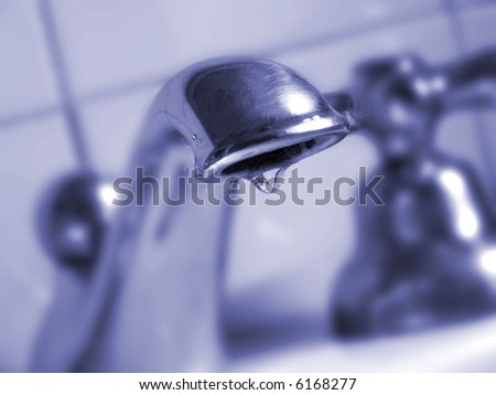 faucet detail with a water drop - stock photo