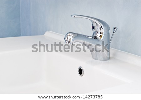 faucet on white sink in bathroom