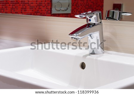 faucet on white sink in modern bathroom