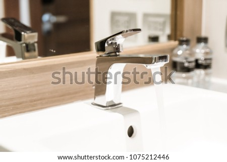 faucet or tap in luxury restroom and toilet #1075212446