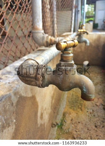 Faucet. Pinchbeck faucet. #1163936233
