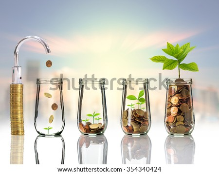 Faucet putting Gold coins and seed in clear bottle on cityscape photo blurred cityscape background,Business investment growth concept