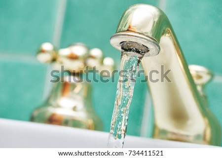 faucet tap with flowing water