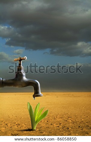 faucet with drop of water in the desert