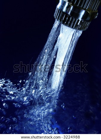 Faucet with sparkling blue water and lots of bubbles