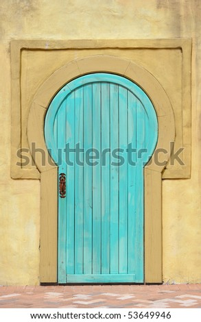 stock-photo-faux-old-blue-door-on-gold-stucco-building-53649946.jpg