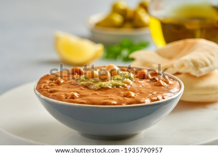 Fava beans dip. Traditional egyptian, middle eastern food foul medames with olive oil. Closeup Сток-фото ©