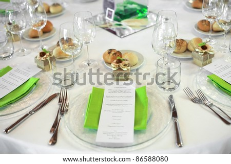 favor on Fancy table set for a wedding with focus on menu