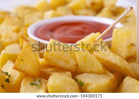 Tapas, Patatas Bravas is fried potato cubes with a spicy tomato sauce ...
