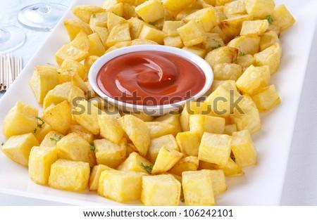 Favourite Spanish Tapas, Patatas Bravas is fried potato cubes with a spicy tomato sauce flavoured with smoked paprika.