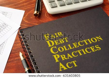 FDCPA Fair Debt Collection Practices Act on a table. #631603805